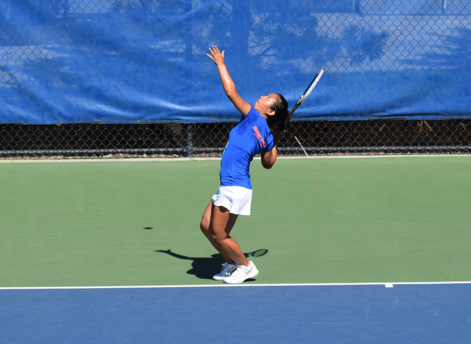 Bobbi Oshiro won both her doubles and singles matches.