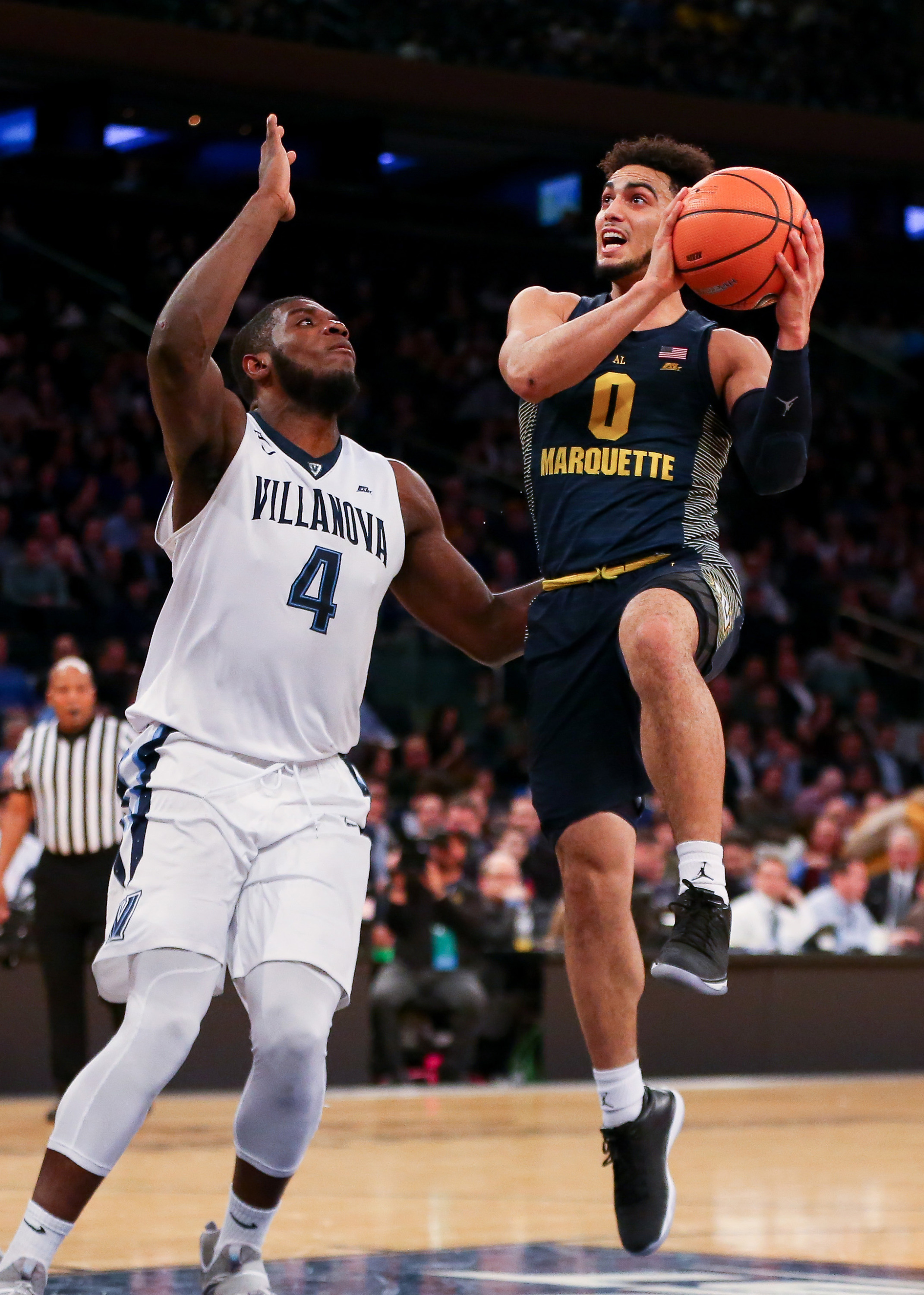 Markus Howard had 16 points in the first half as Marquette trailed by seven at the break (photo: Vincent Carchietta, USA TODAY Sports)