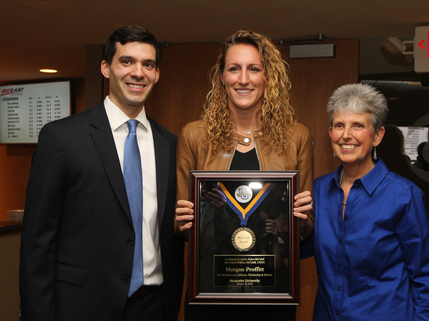 Morgan Proffitt (center), who was given her McCahill Award in January, will be honored again on April 27.