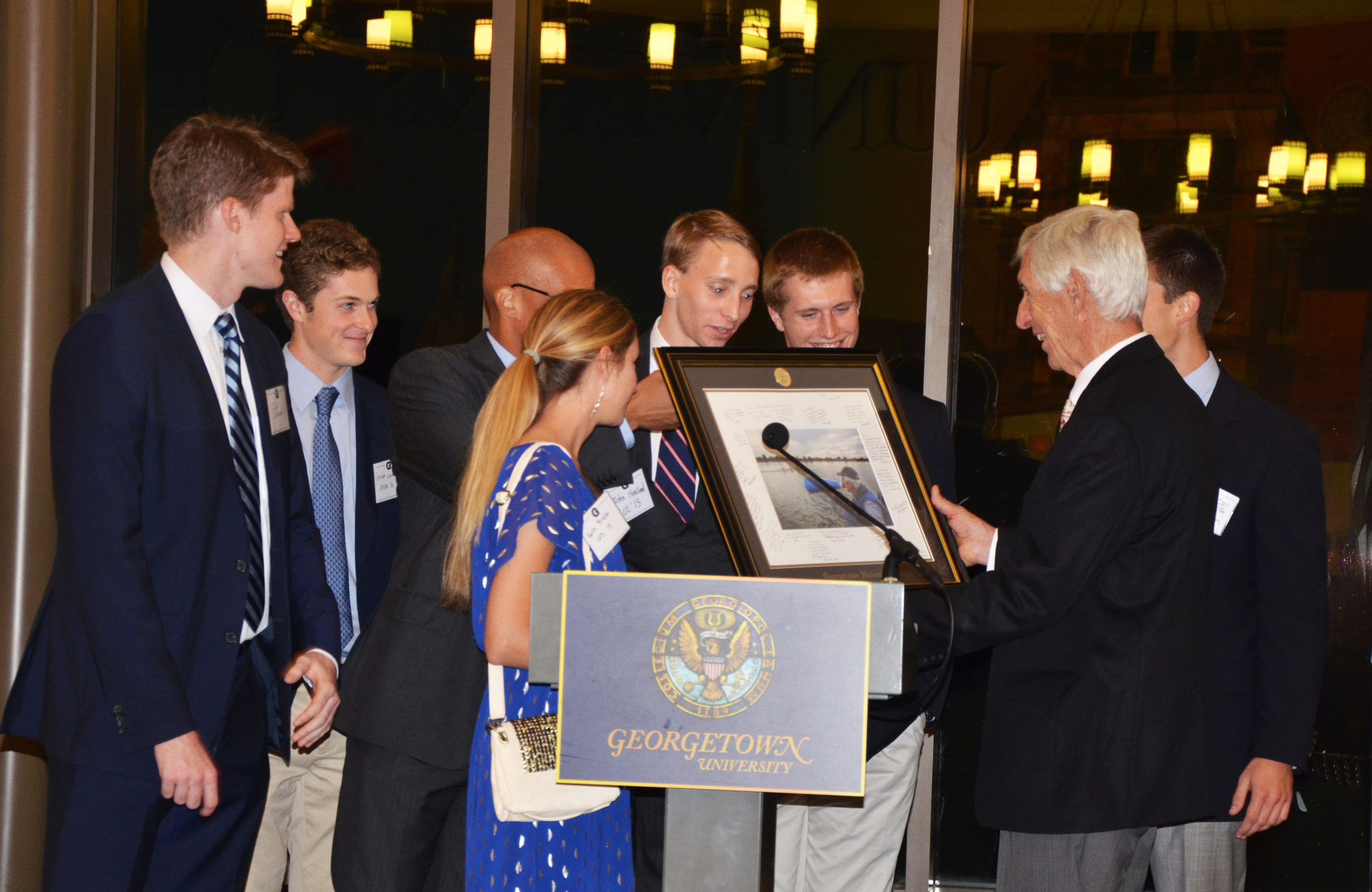 Tony Johnson receives his gift from the Georgetown Rowing Class of 2015.