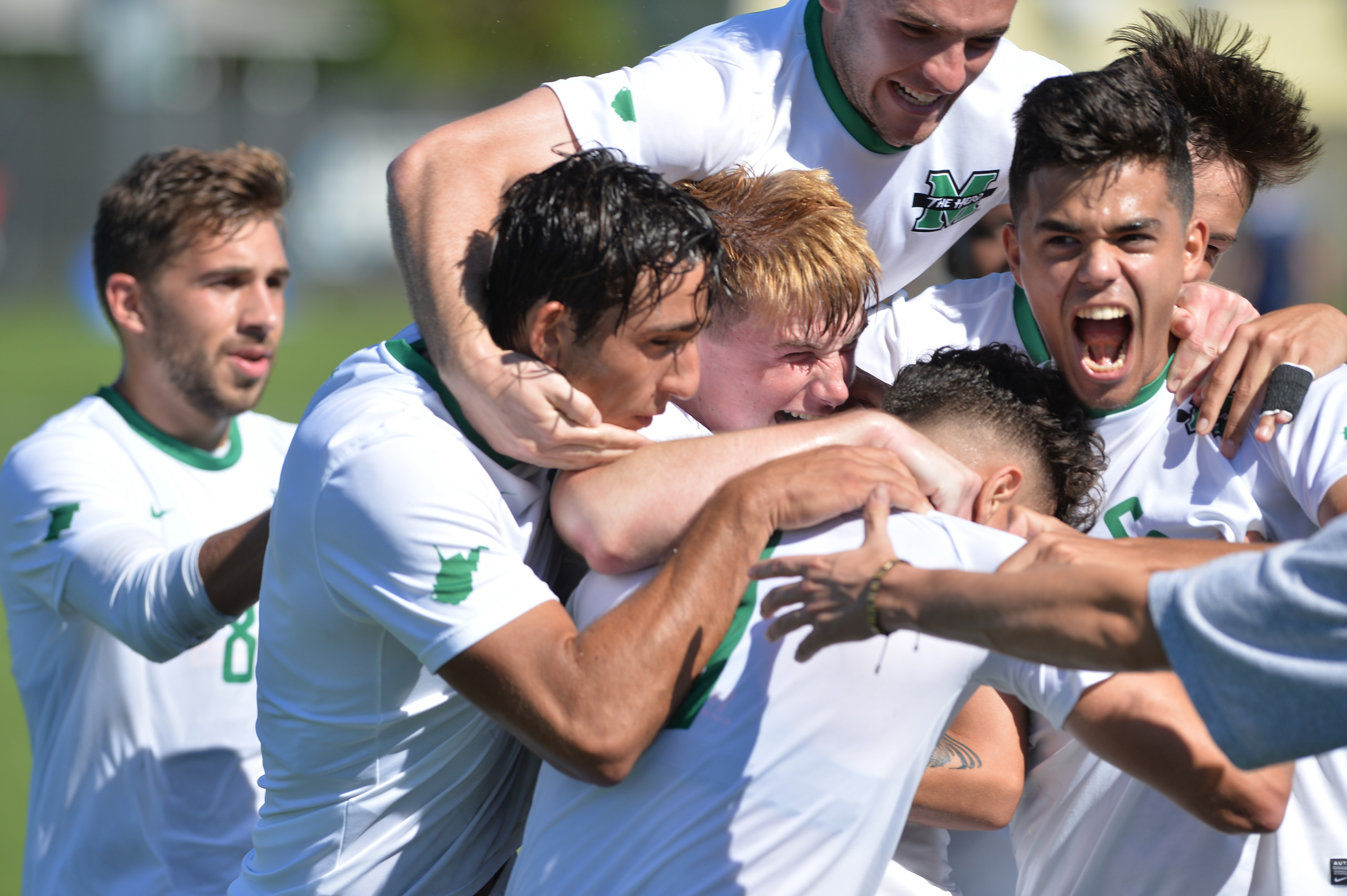 Marshall celebrates after Lewis Knight's goal against Kentucky on Oct. 14.