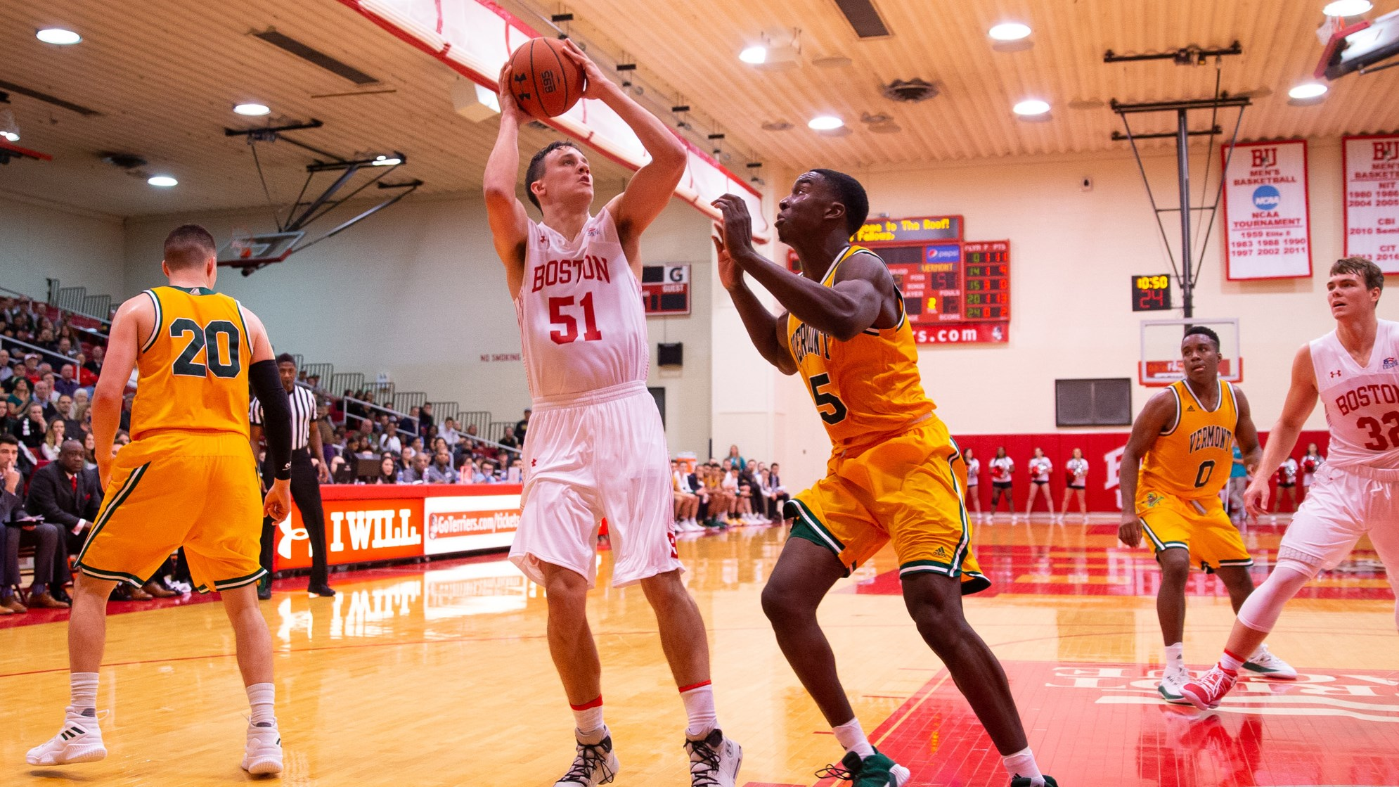 Max Mahoney attempts a jumper from the baseline against Vermont.